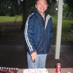 Wei cutting his cake